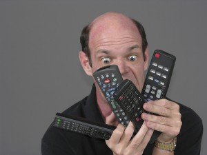 man with too many remotes